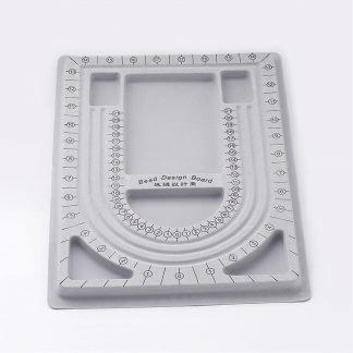 Dit grijze sieradenbord is te koop bij kralenwinkel Limited Edition in Den Haag.