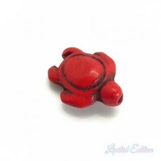 Deze synthetische howlite schildpad kraal is te koop bij kralenwinkel Limited Edition in Den Haag in de kleur rood.