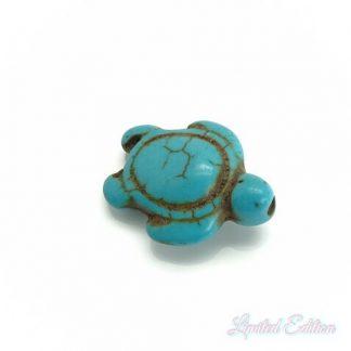 Deze synthetische howlite schildpad kraal is te koop bij kralenwinkel Limited Edition in Den Haag in de kleur turquoise.