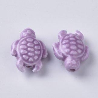 Deze porseleinen schildpad kraal is te koop bij kralenwinkel Limited Edition in Den Haag in de kleur paars.