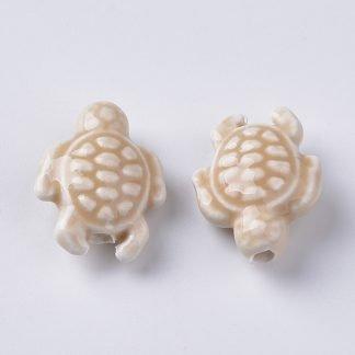 Deze porseleinen schildpad kraal is te koop bij kralenwinkel Limited Edition in Den Haag in de kleur wit.