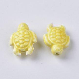 Deze porseleinen schildpad kraal is te koop bij kralenwinkel Limited Edition in Den Haag in de kleur geel.