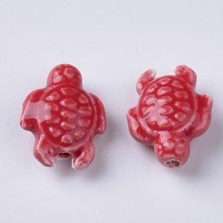 Deze porseleinen schildpad kraal is te koop bij kralenwinkel Limited Edition in Den Haag in de kleur rood.