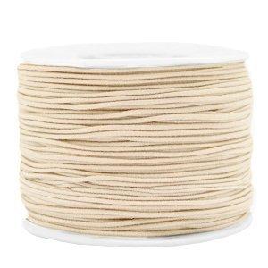 Dit gekleurde elastiek is 1,2mm dik en is te koop bij kralenwinkel Limited Edition in Den Haag in de kleur beige.