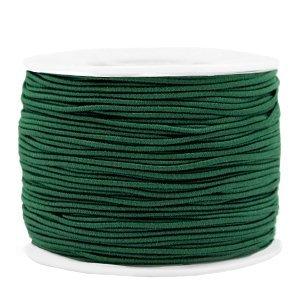Dit gekleurde elastiek is 1,2mm dik en is te koop bij kralenwinkel Limited Edition in Den Haag in de kleur donker groen.
