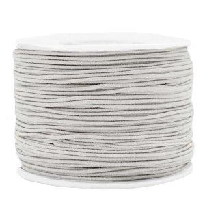 Dit gekleurde elastiek is 1,2mm dik en is te koop bij kralenwinkel Limited Edition in Den Haag in de kleur licht grijs.