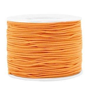 Dit gekleurde elastiek is 1,2mm dik en is te koop bij kralenwinkel Limited Edition in Den Haag in de kleur oranje.