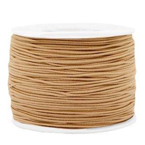 Dit gekleurde elastiek is 1,2mm dik en is te koop bij kralenwinkel Limited Edition in Den Haag in de kleur licht bruin.
