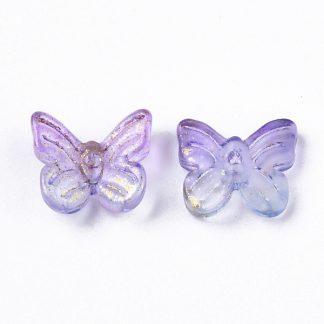 Deze glazen bedel in de vorm van een vlinder is te koop bij kralenwinkel Limited Edition in Den Haag in de kleur paars met goud.