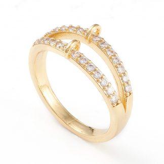 Deze ring met steentjes en loop is te koop bij kralenwinkel Limited Edition in Den Haag in de kleur goud.