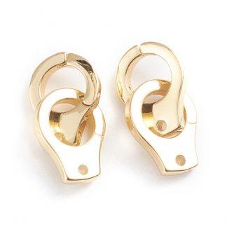Deze bedel in de vorm van handboeien is te koop bij kralenwinkel Limited Edition in de kleur goud.